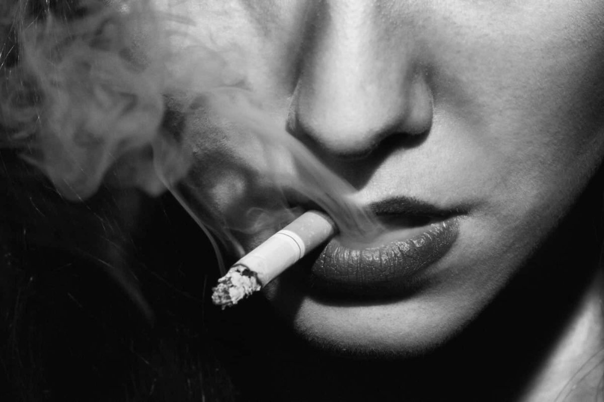 noir woman smoking portrait