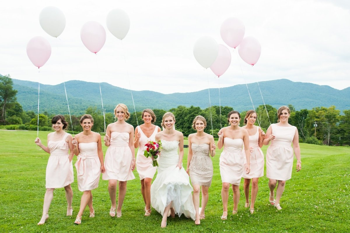 bridesmaids with bride photo holding balloons