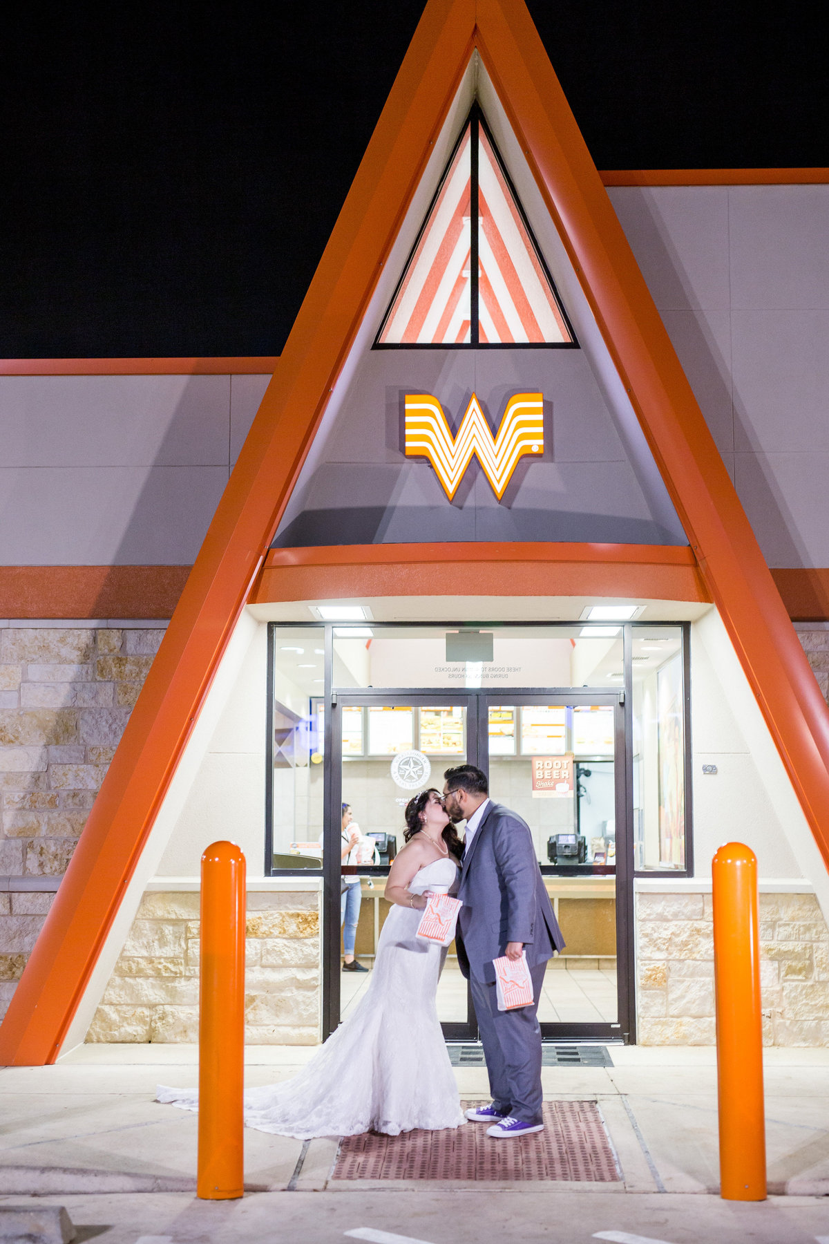 bride and groom get food at Whataburger after wedding reception