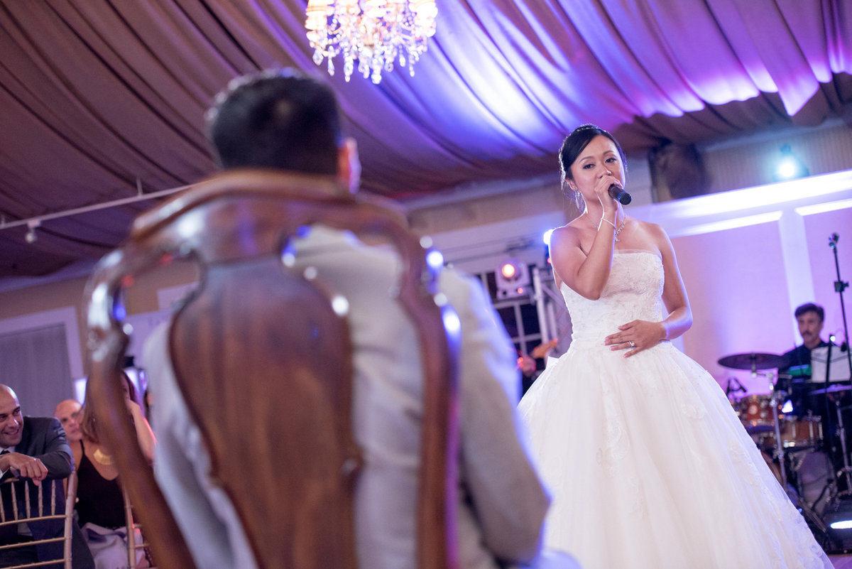 Bride singing to her groom at Bridgeview Yacht Club