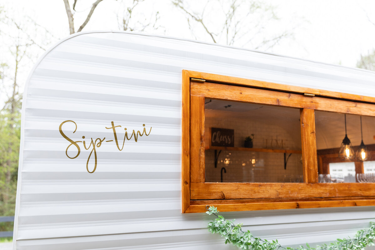 Sip-tini Champagne Camper at The Carriage House