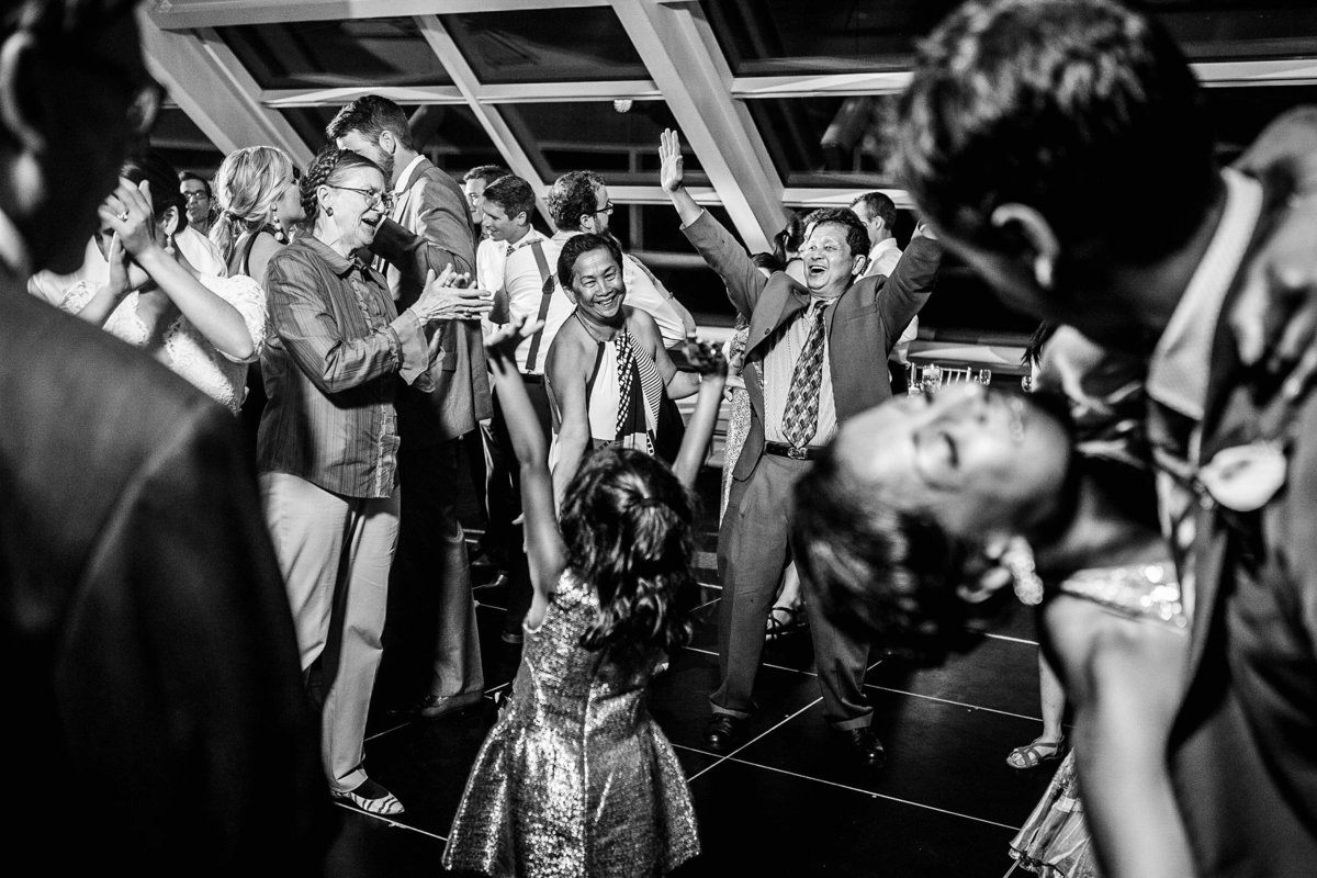 Guests dance together at an Adler Planetarium wedding.