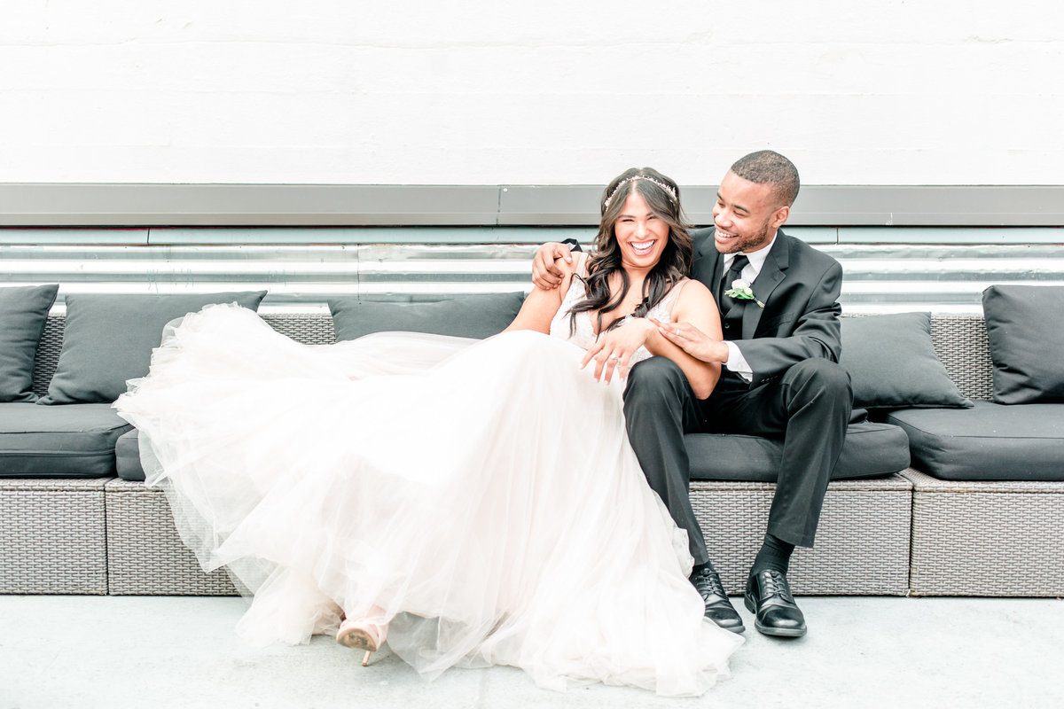 bride-groom-laughing-seattle-rooftop-wedding-venue-tia-larue-photography