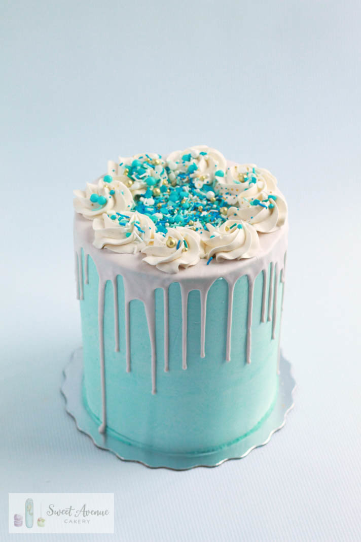 blue chocolate drip cake with sprinkles