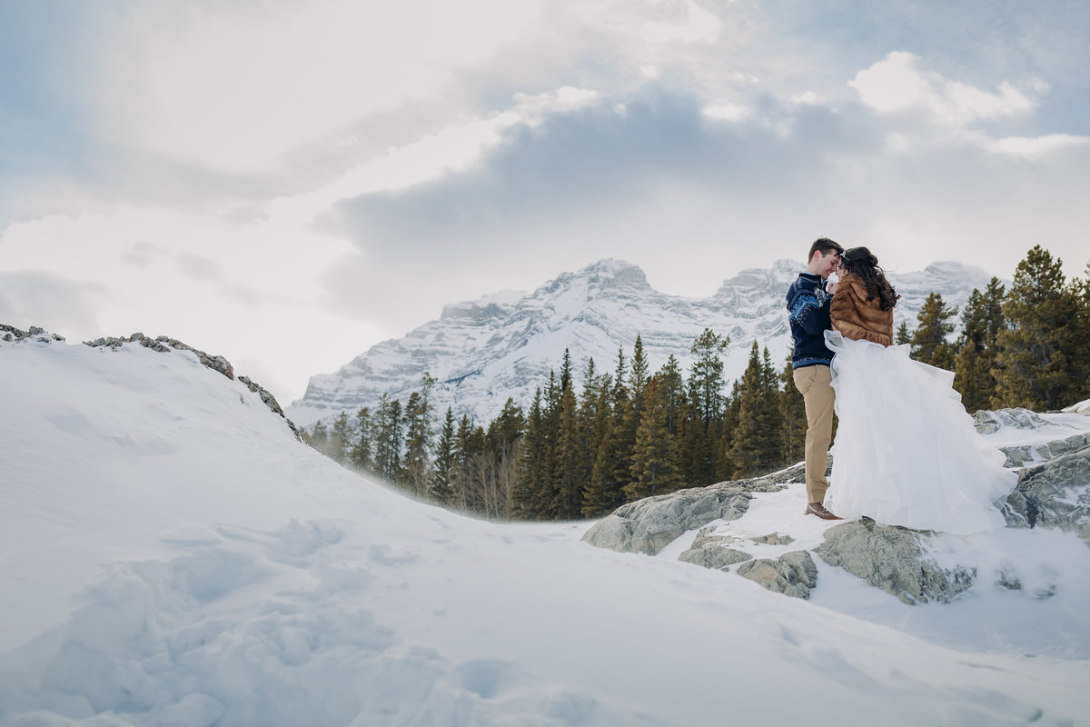 lake minnewanka winter elopement photographer banff