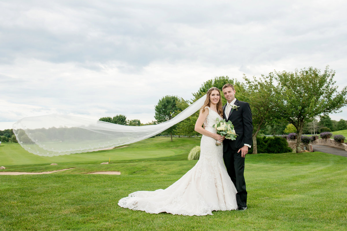 wide shot of bride and groom on the golf course at Willow Creek Golf and Country Club wedding