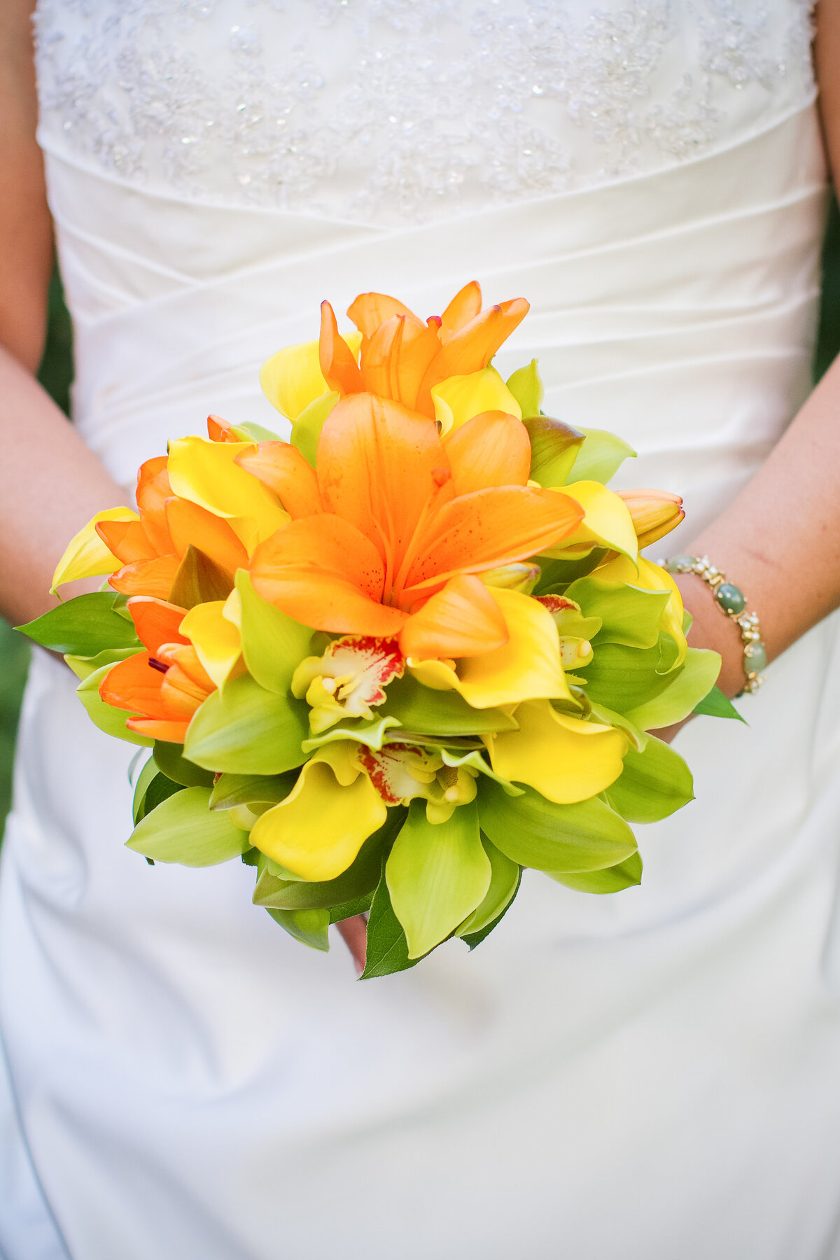 Photo of a Tropical Wedding Bouquet in Oranges, Greens and Yellow
