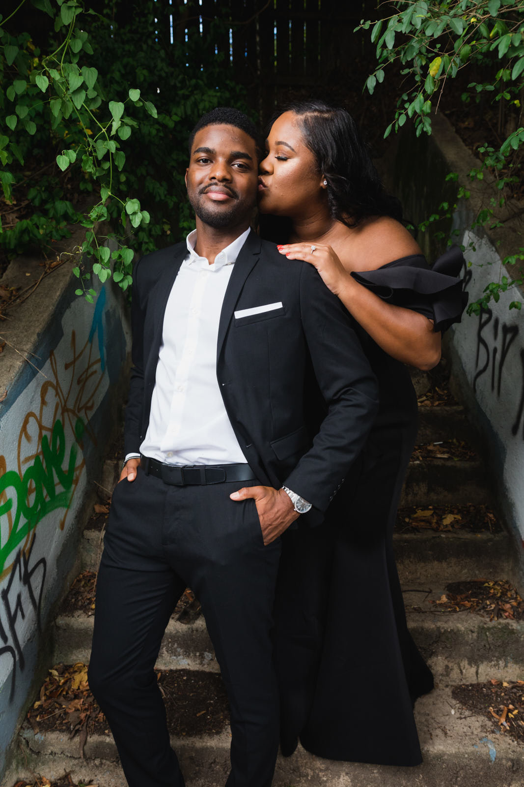 couple kisses on urban stairs for engagement session in Atlanta Old Fourth Ward