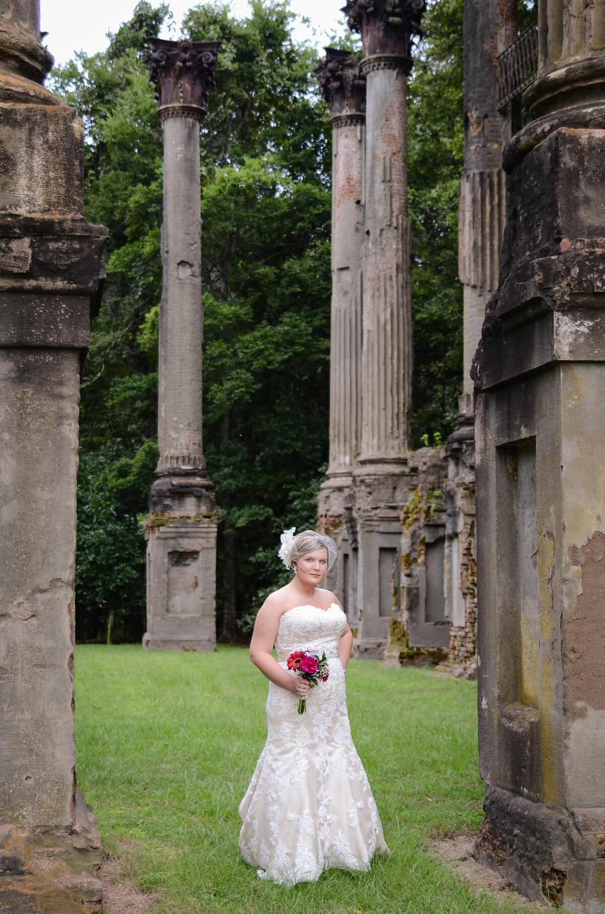 Beautiful bridal portrait photography: bride in vintage gown with birdcage veil among the ruins at Windsor plantation in MS