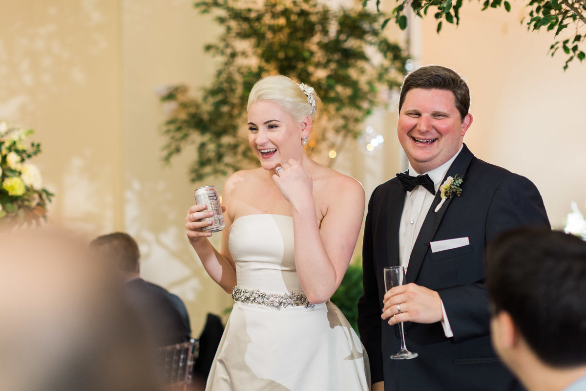 Photojournalism at its best during this couples reception at the Atlanta History Center. Photo by luxury destination wedding photographer Rebecca Cerasani.