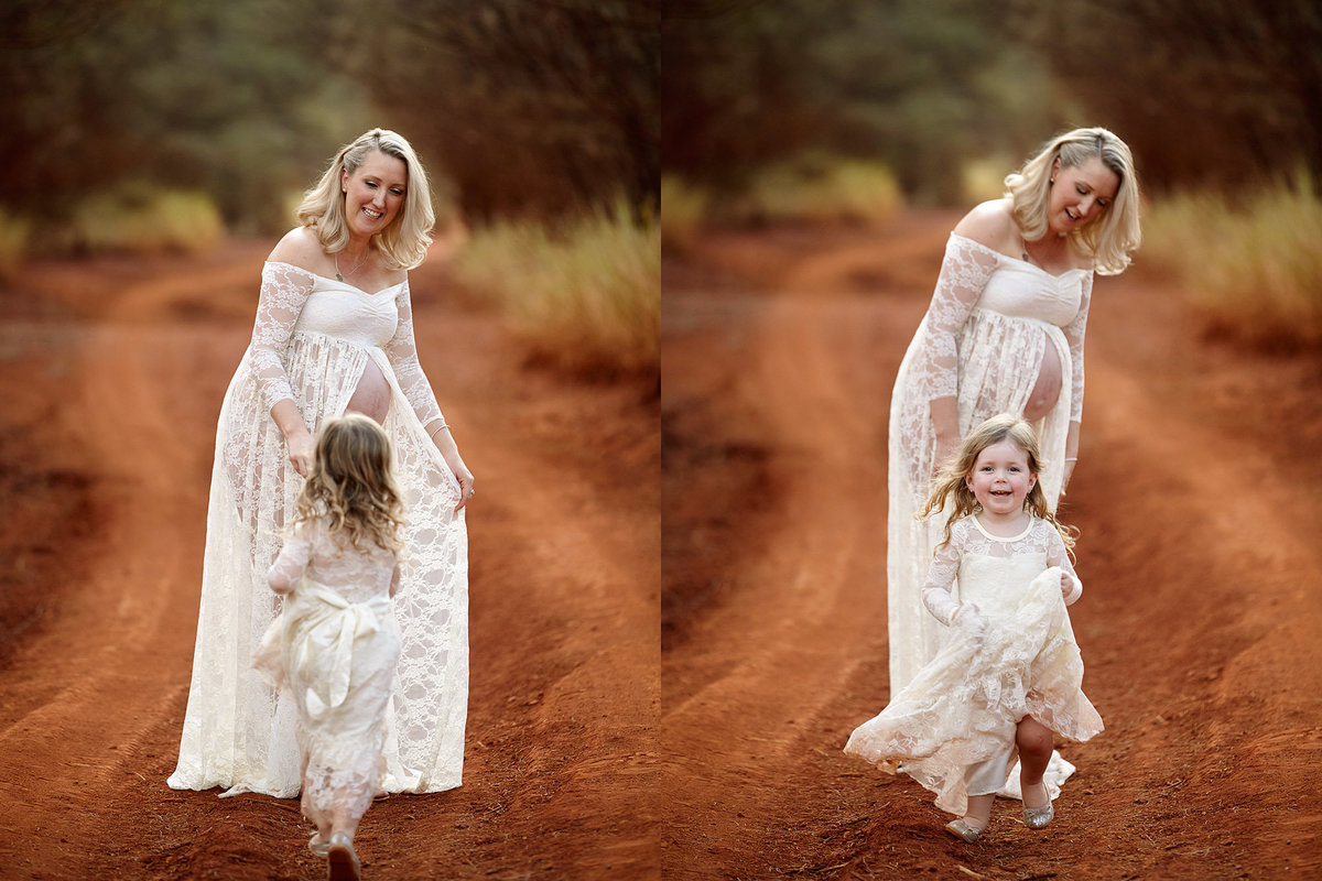 Pregnant mum with a matching white outfit to her daughter playing a game of hide and seek in her dress in a red dirt landscape