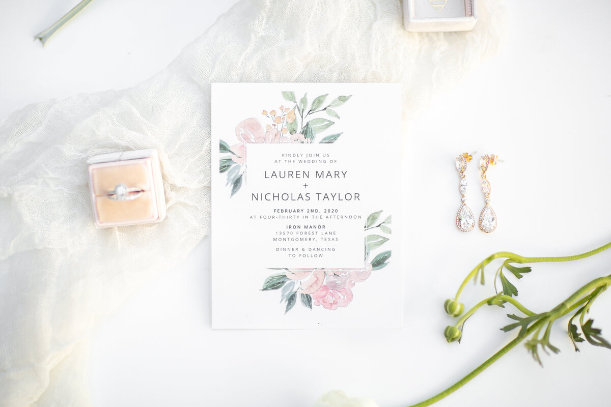 Wedding Detail Flatlay with Invitations and Bridal Jewelry