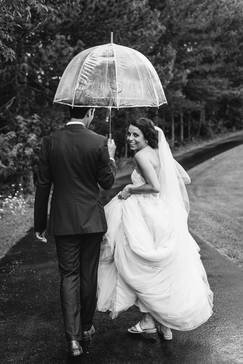 Rainy day black and white wedding photo
