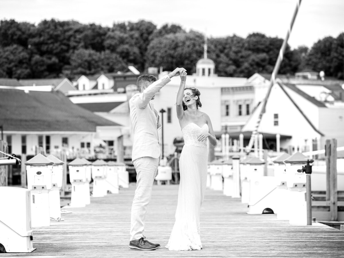 Bride and Groom dancing on boat docks