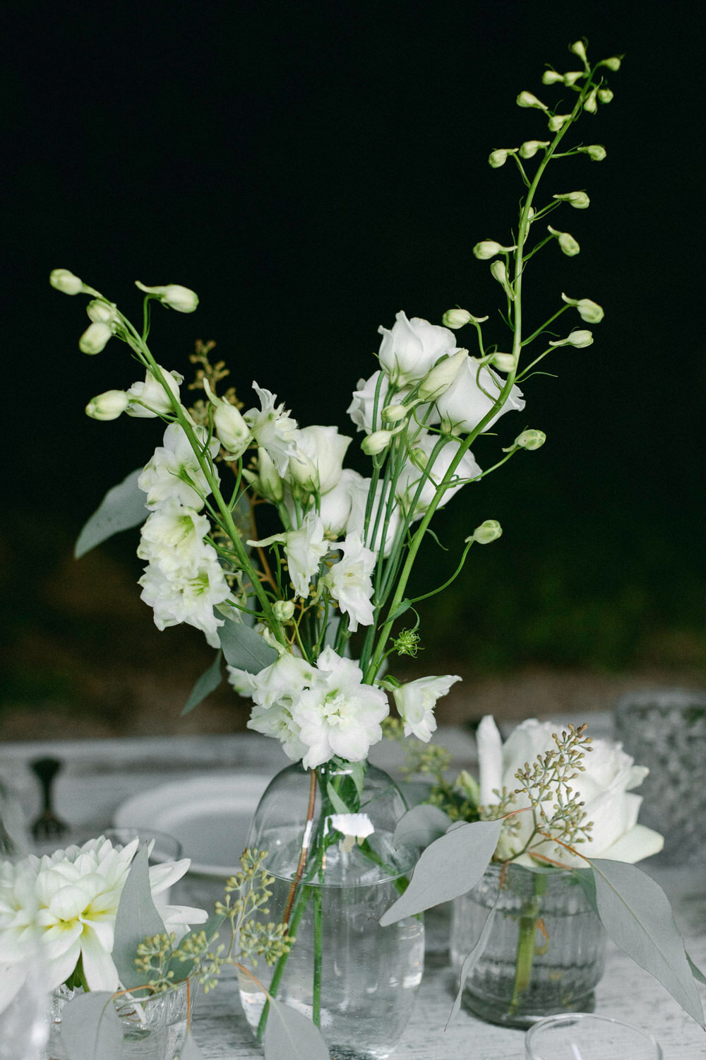 white and green table top floral arrangement