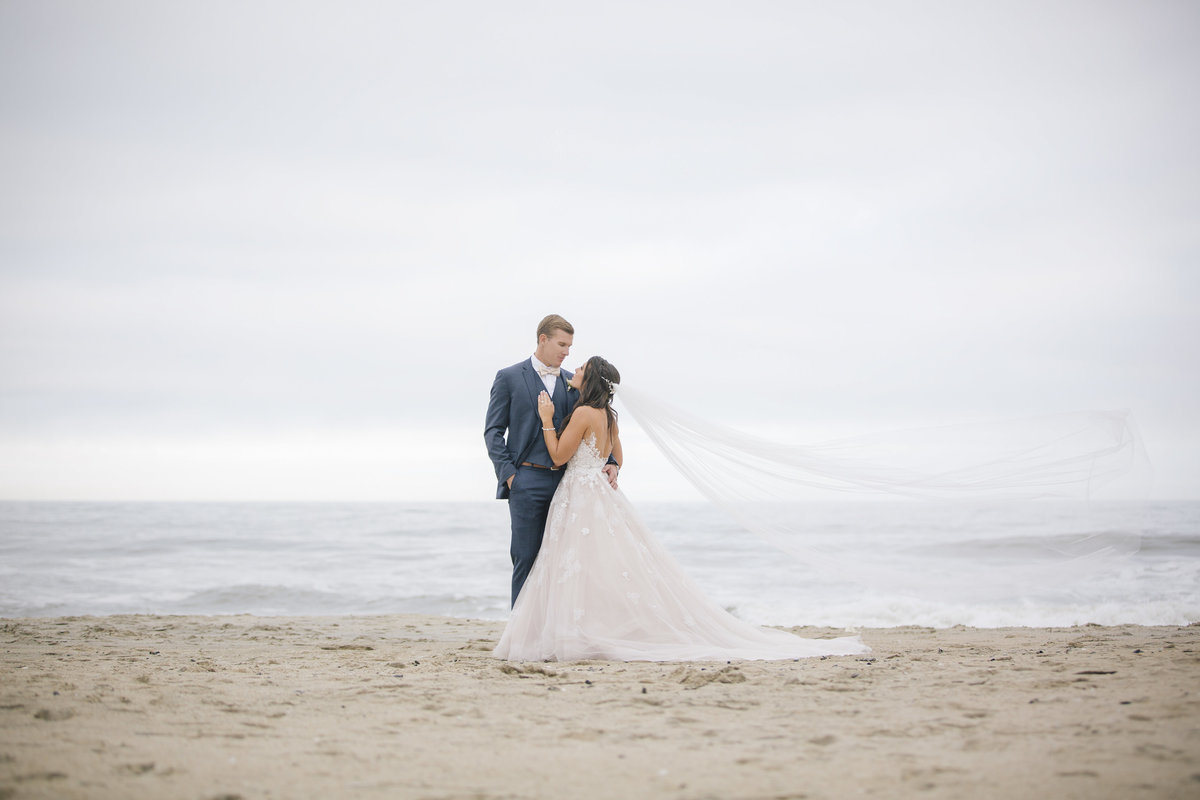 bride and groom on asbury park beach wedding