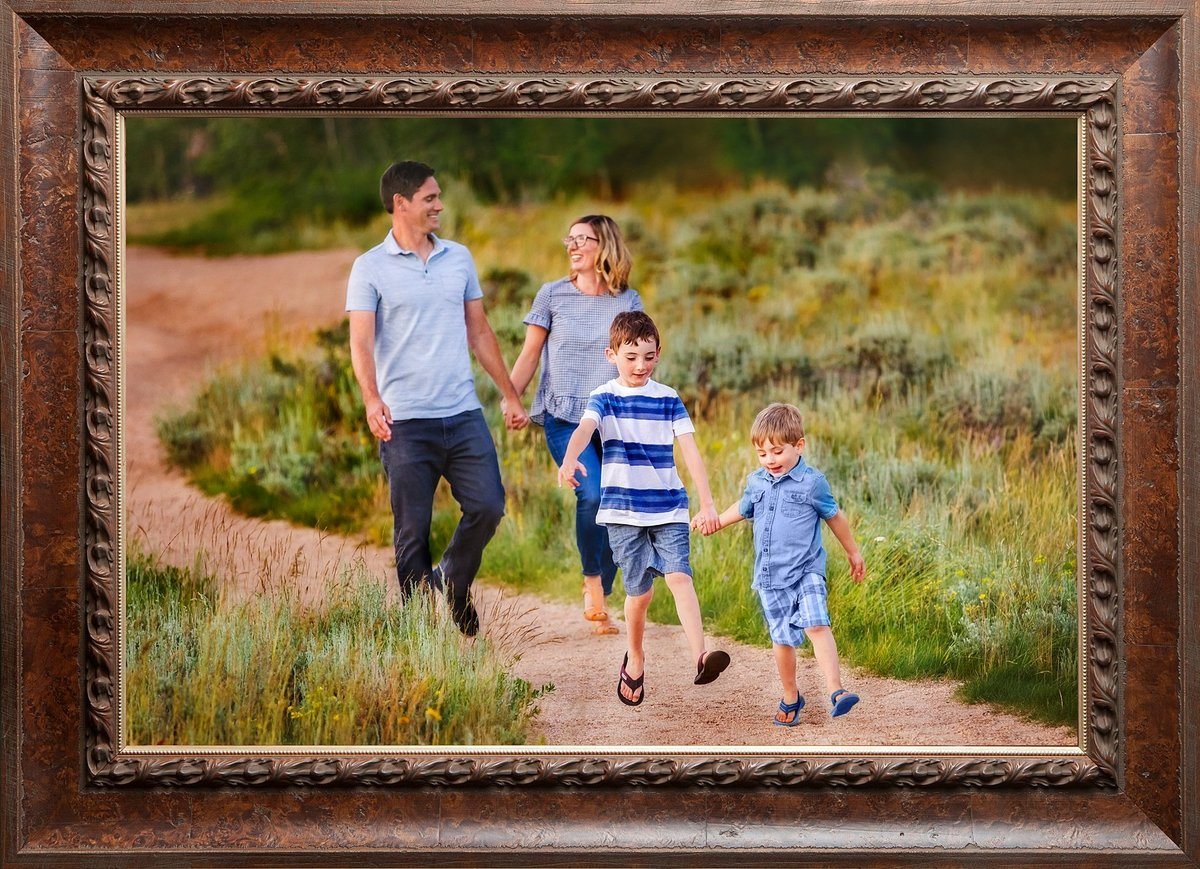Two little boys walking with their parents  on a path at Vedauwoo.
