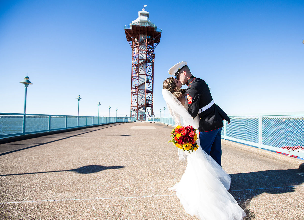 Bride and Groom kiss in front of Bicentennial Tower on Dobbins Landing in Erie, PA
