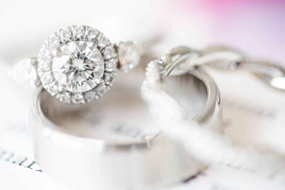 Close up detail of wedding rings in preparation for the bride and groom at villa de amore by matty fran photography