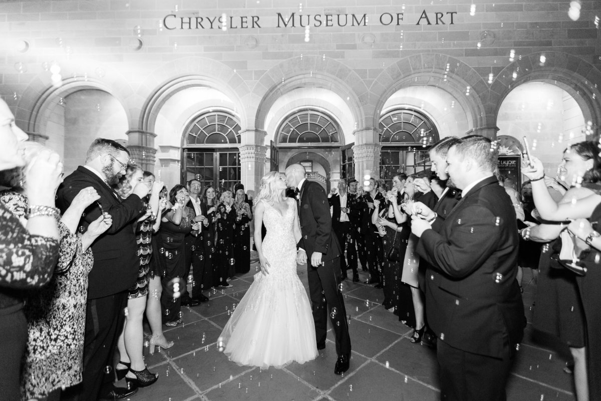 bride and groom leaving the Chrysler Museum with a bubble exit