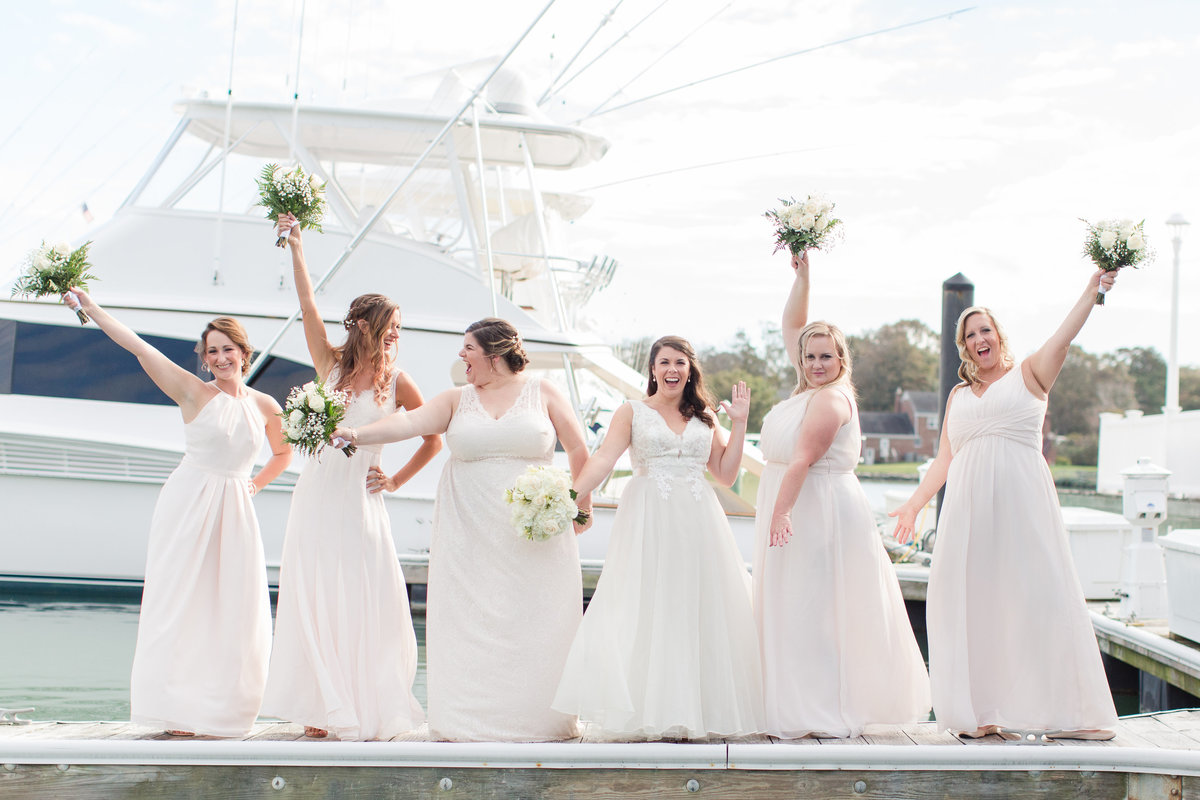 Bridesmaids cheering on the dock at The Water Table