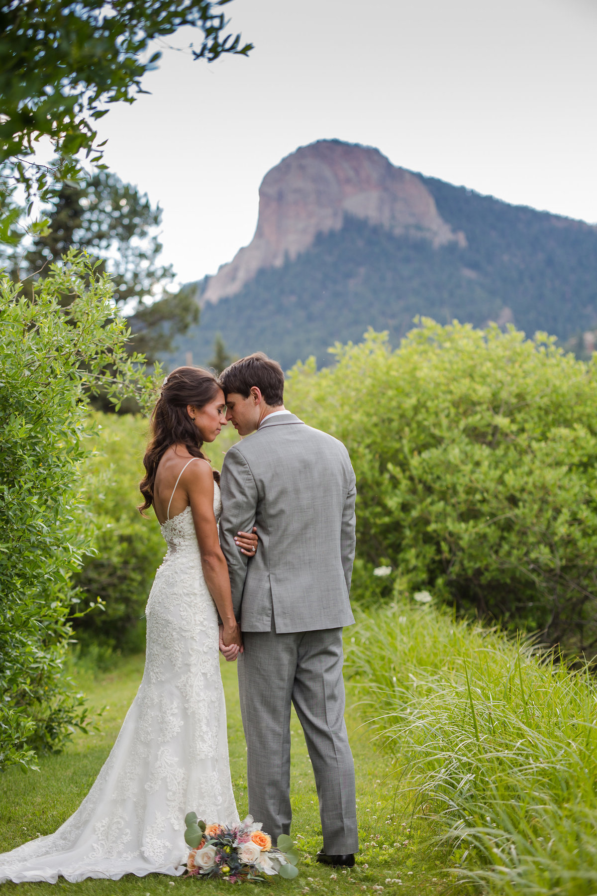 Bride and Groom with mountains lower lake ranch.