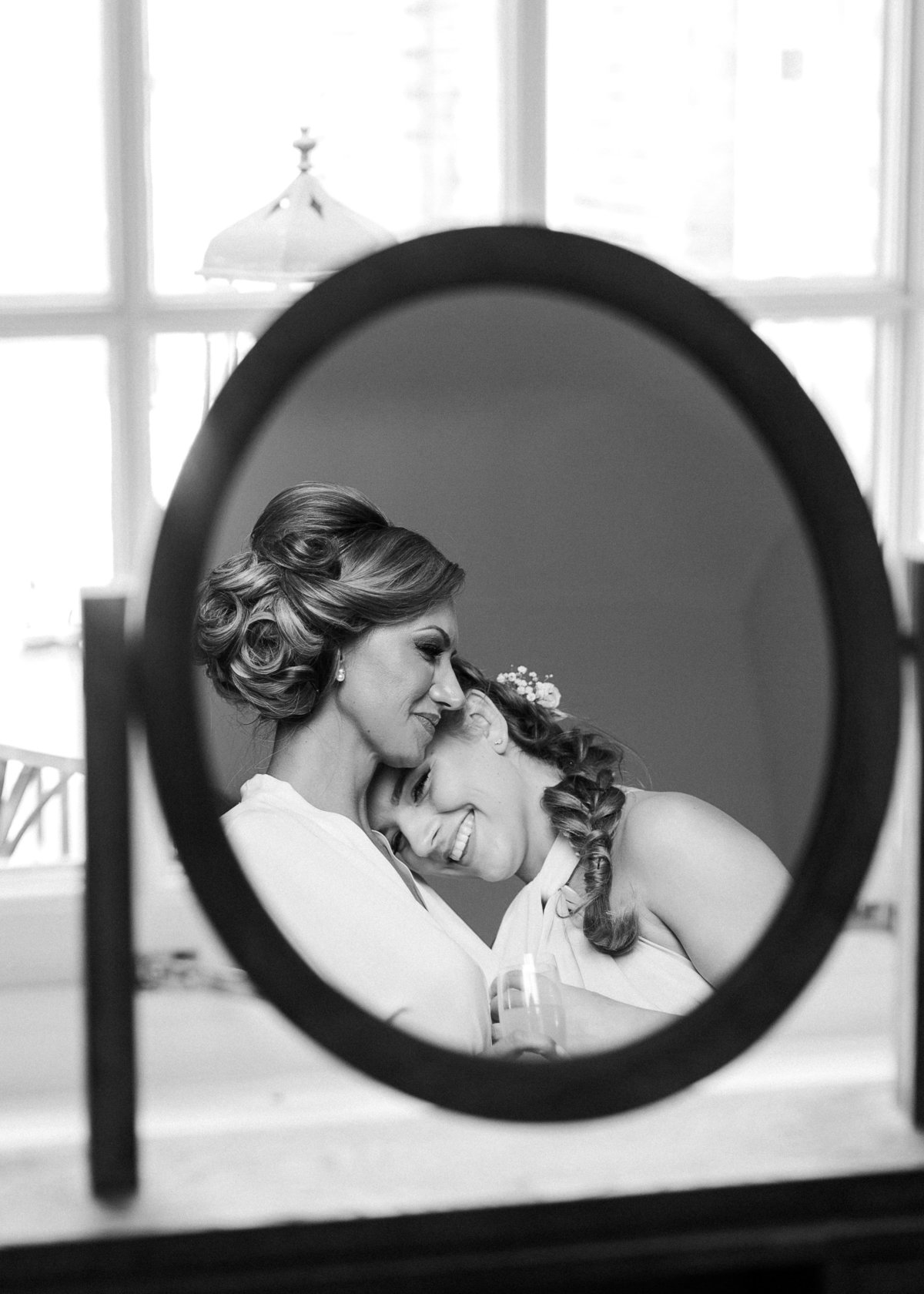 Mother and daughter are captured having a moment together during the bridal prep at Southend Barns