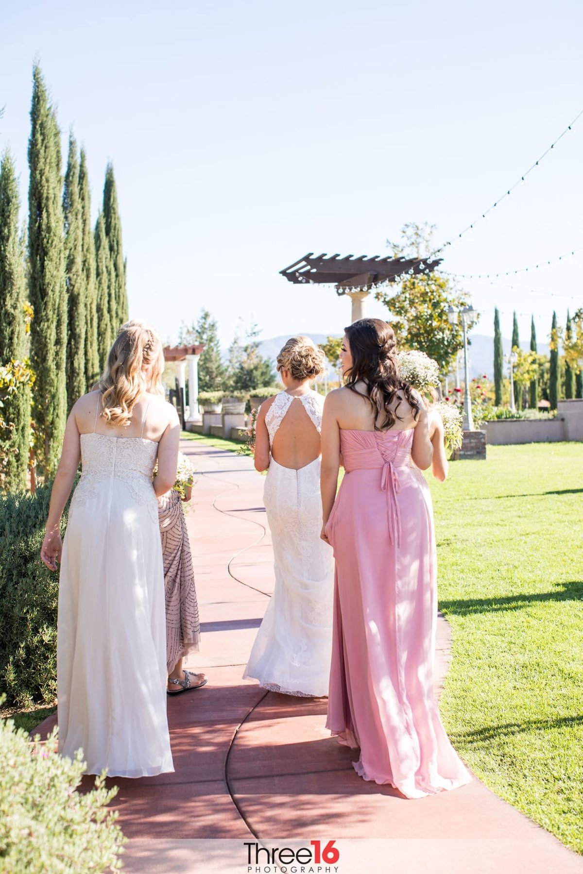 Bride and her Bridesmaids head to the ceremony