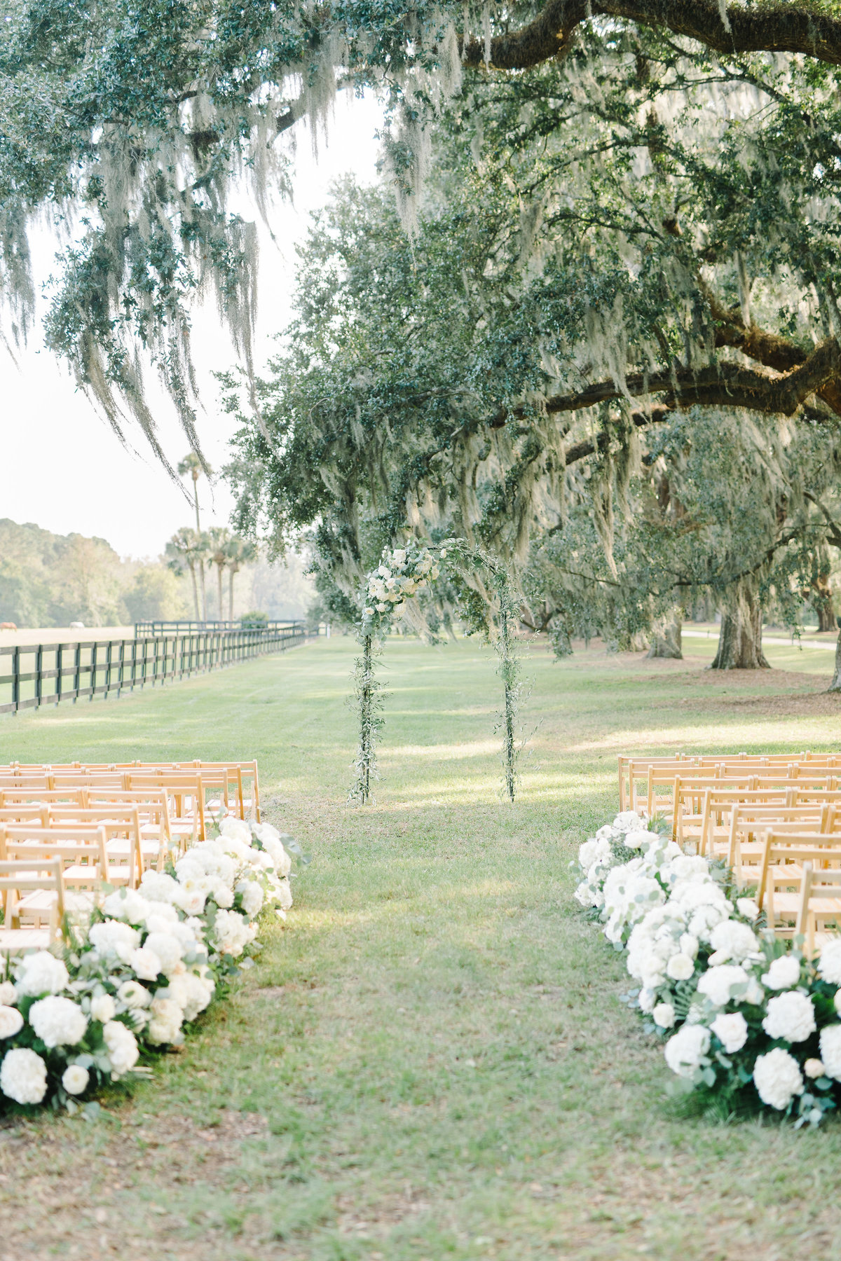 Wedding Ceremony Floral Lined Aisle with White Hydrangeas and Greenery Boone Hall Planation Avenue of Oaks