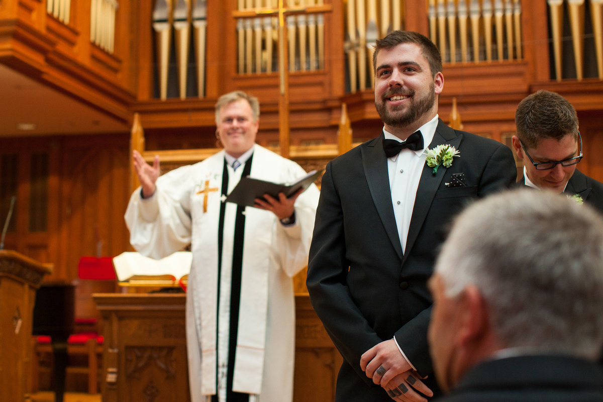 groom sees bride for first time as she comes down the aisle