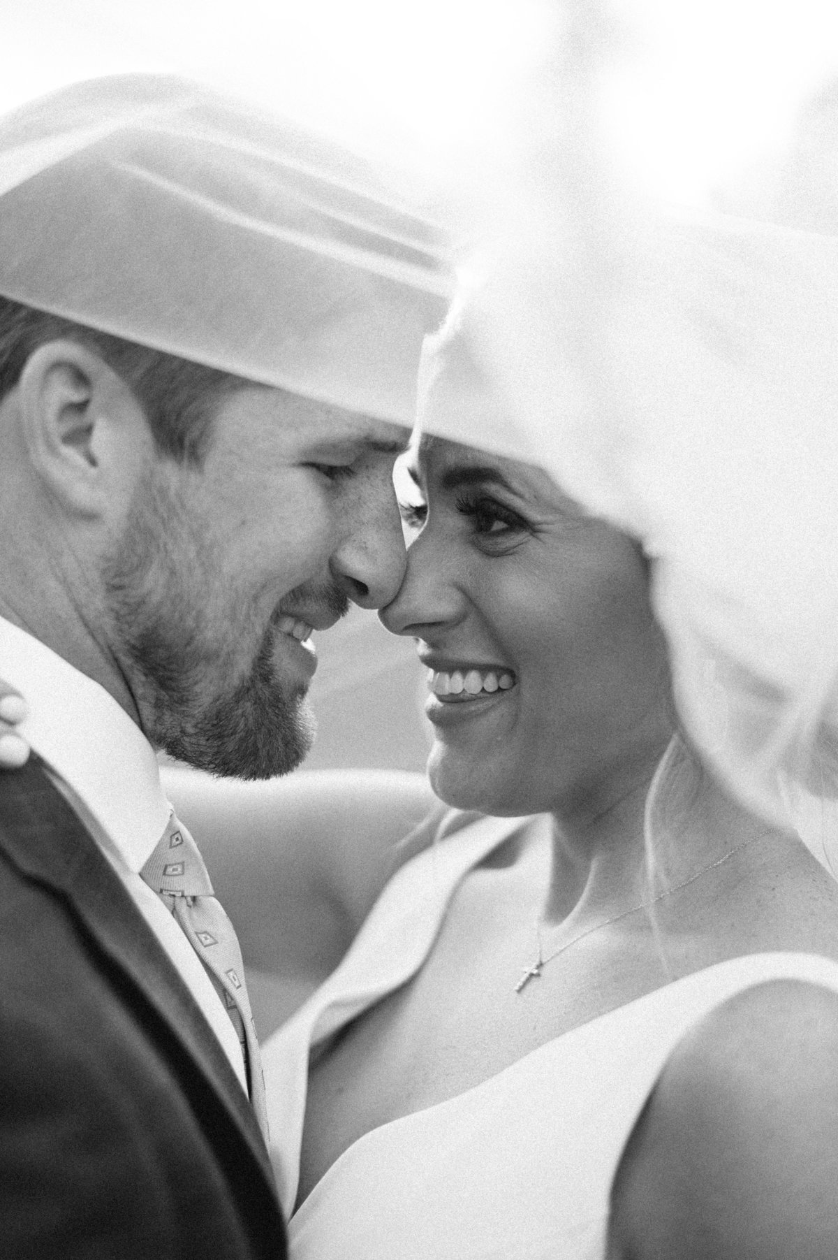 Gorgeous black and white veil photo of couple getting married at Park Crest Hoover AL
