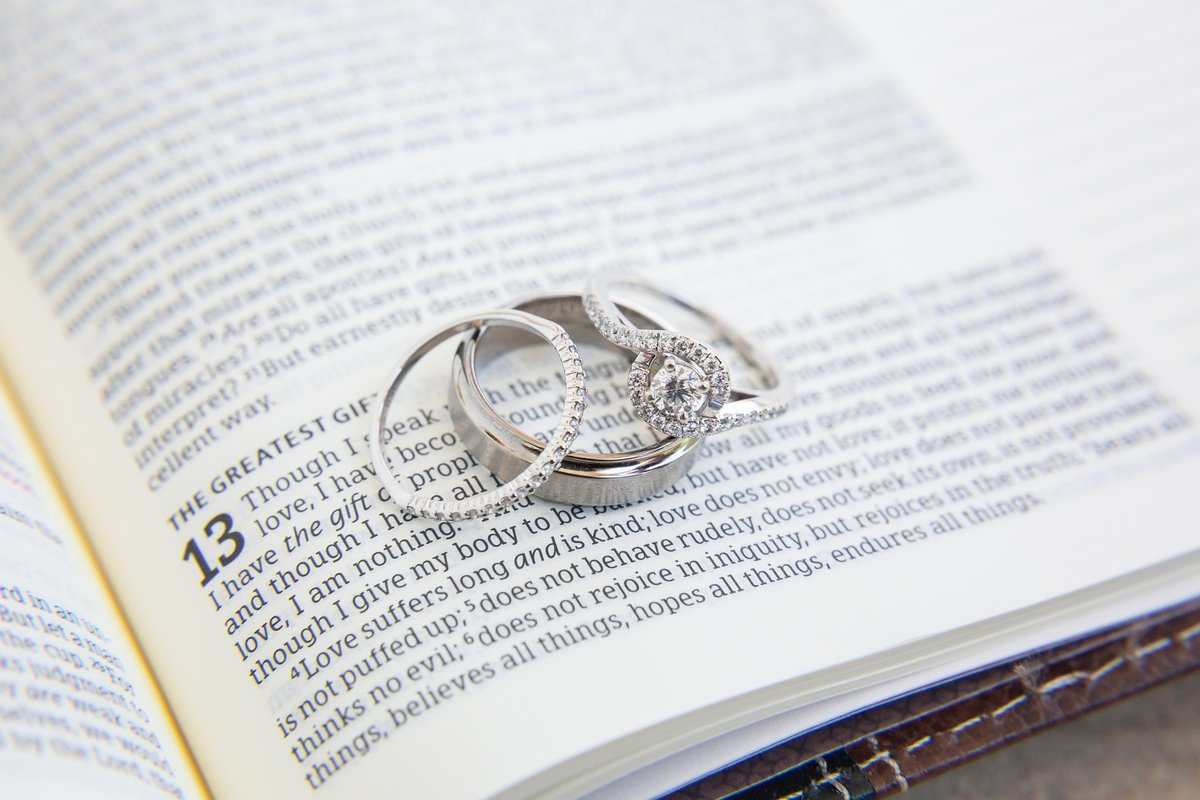 wedding bands and engagement ring detail shot on the Bible verse love is patient
