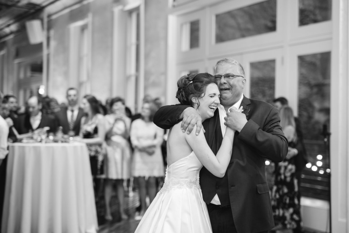 Bride and dad happy crying during Father Daughter dance