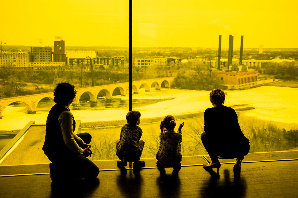 LGBT family looking at Minneapolis skyline