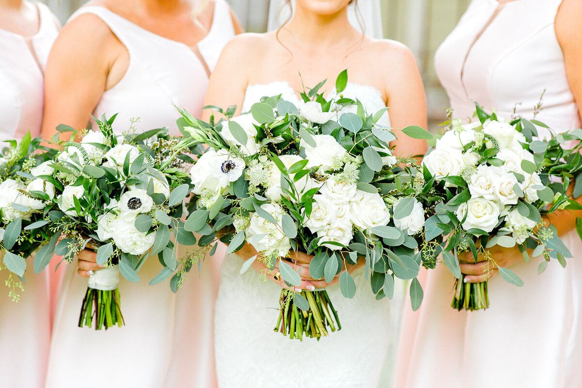 Close up of bride and bridesmaid white bouquets