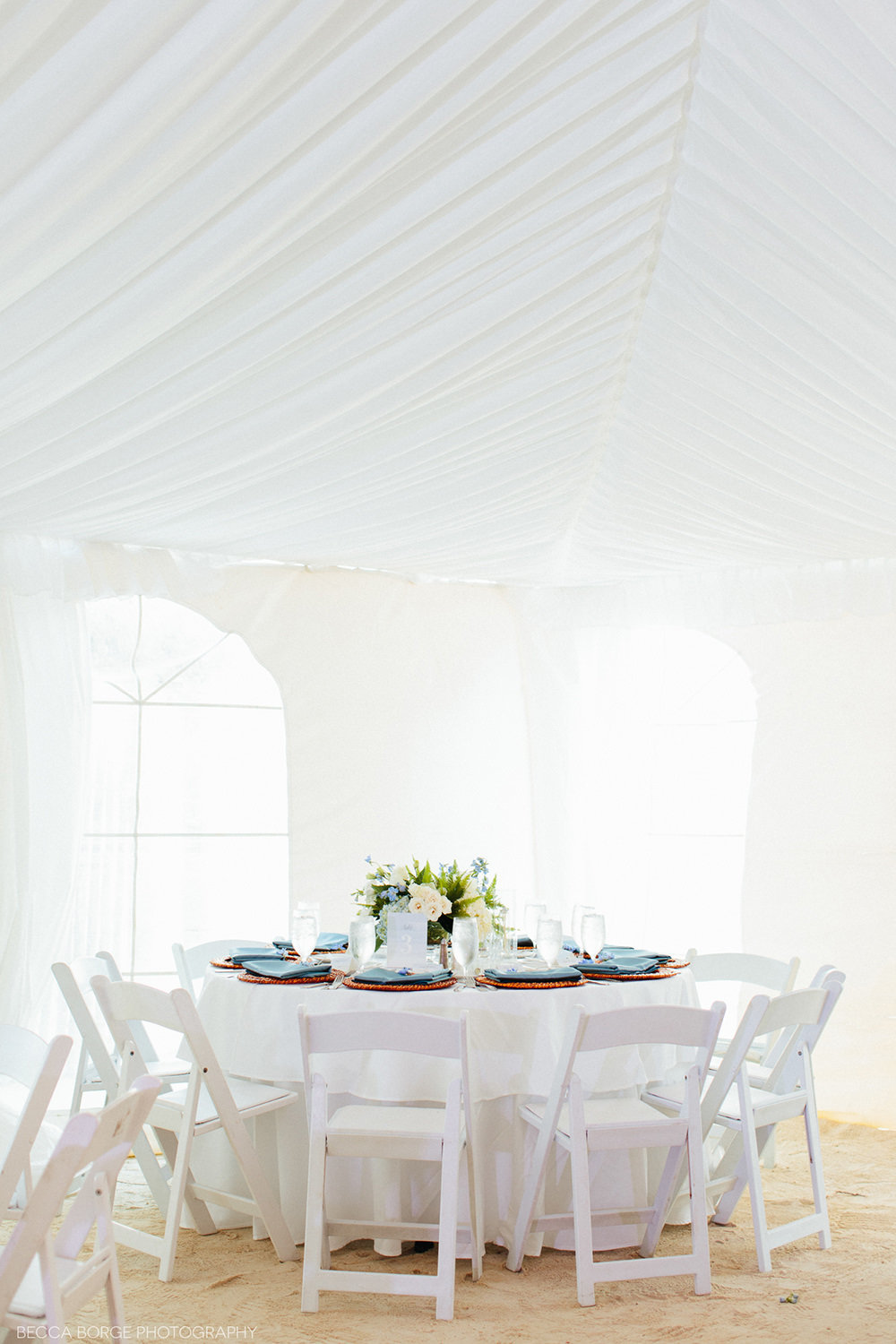 wedding reception table in blue and white