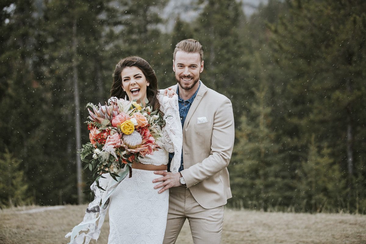 Romantic bride and groom in luxurious mountain wedding