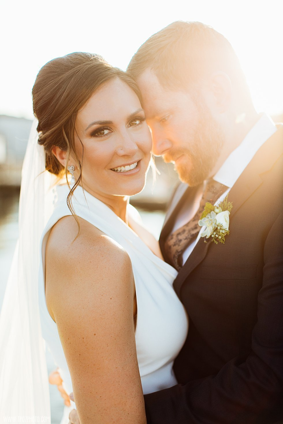 Golden sunflare on a Baltimore bride and groom
