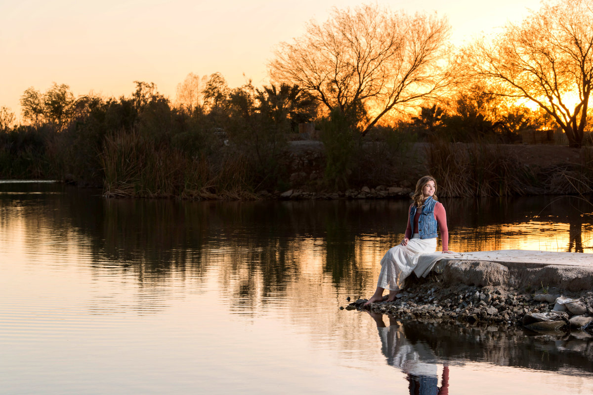 senior with sunset and pond