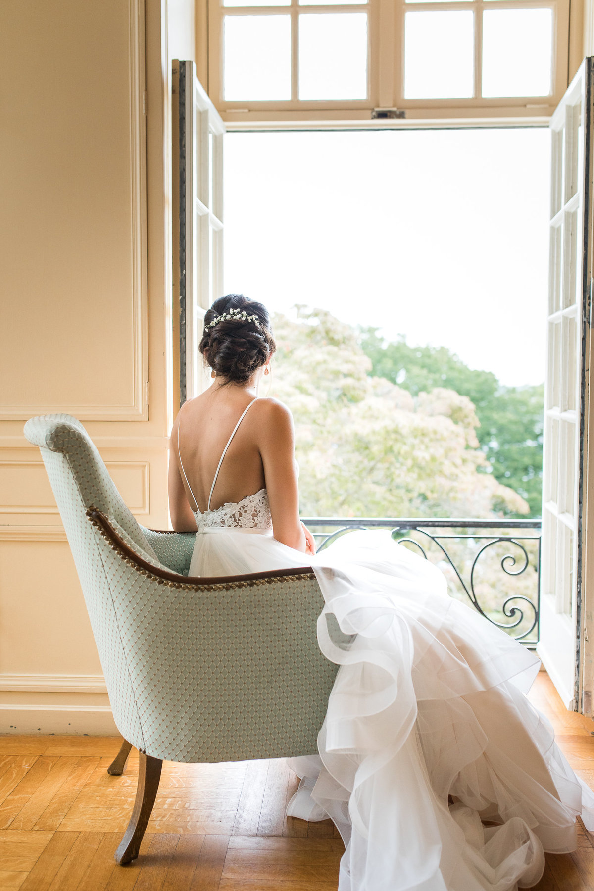 Bride overlooks the field at Glen Manor House before her wedding ceremoy