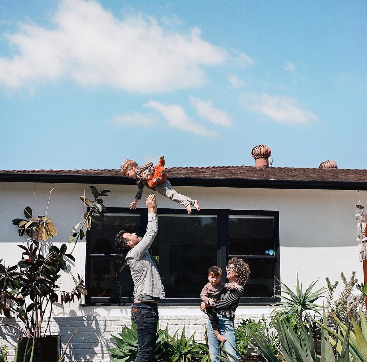 family-playing-backyard-los-angeles