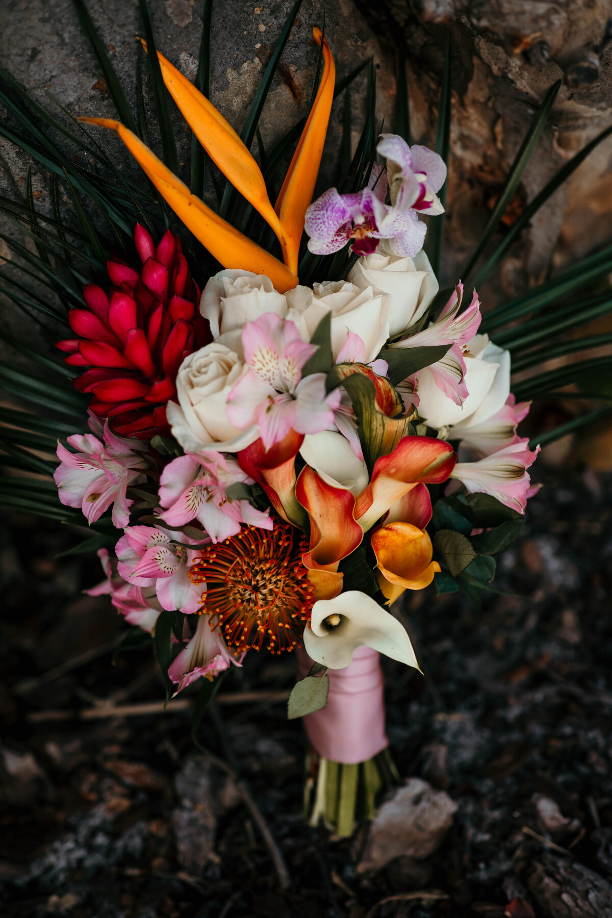 A picture of the bride's beautiful bouquet of roses and exotic flowers, showing both the strong and delicate colors by Garry & Stacy Photography Co - Sarasota Florida wedding photography