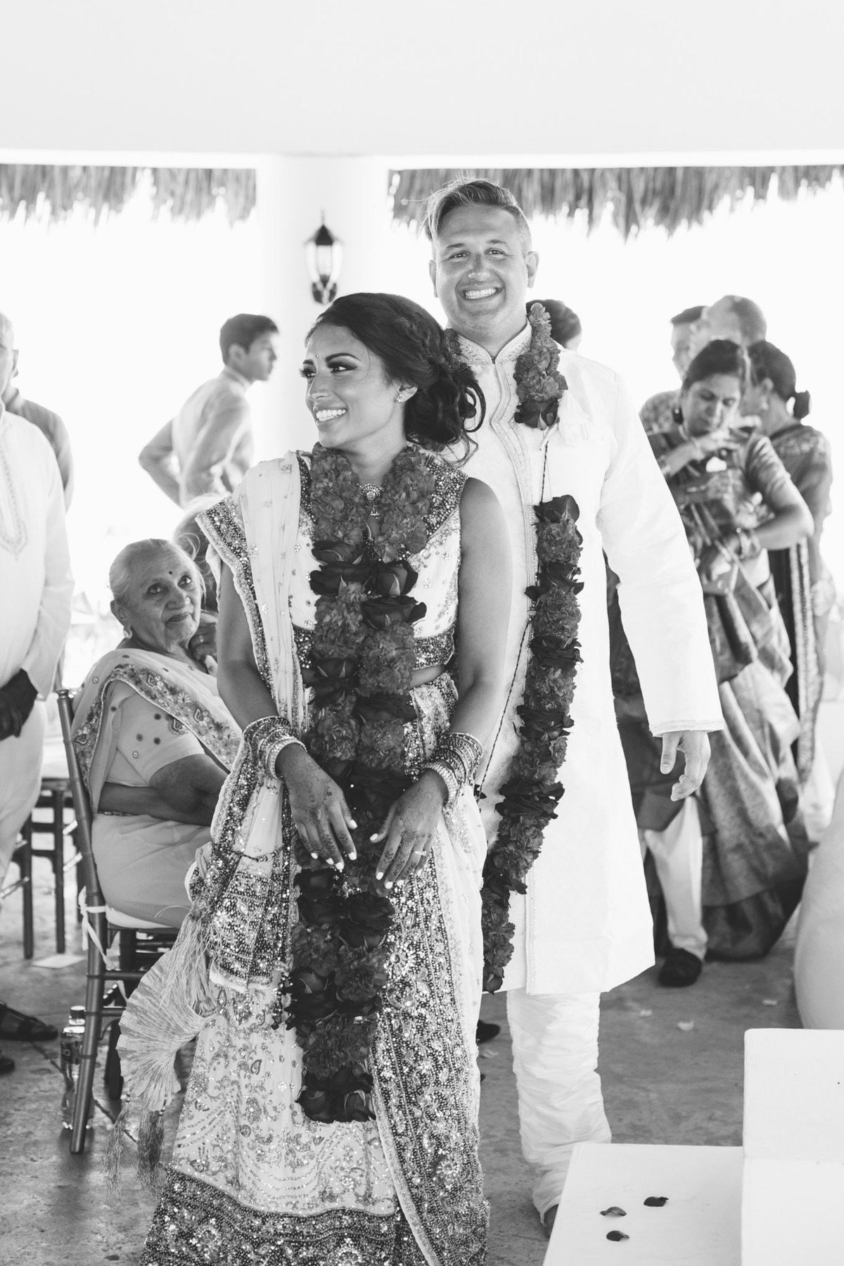 Joy from a bride and groom at the close of their Indian wedding ceremony.  Photography by Rebecca Cerasani.