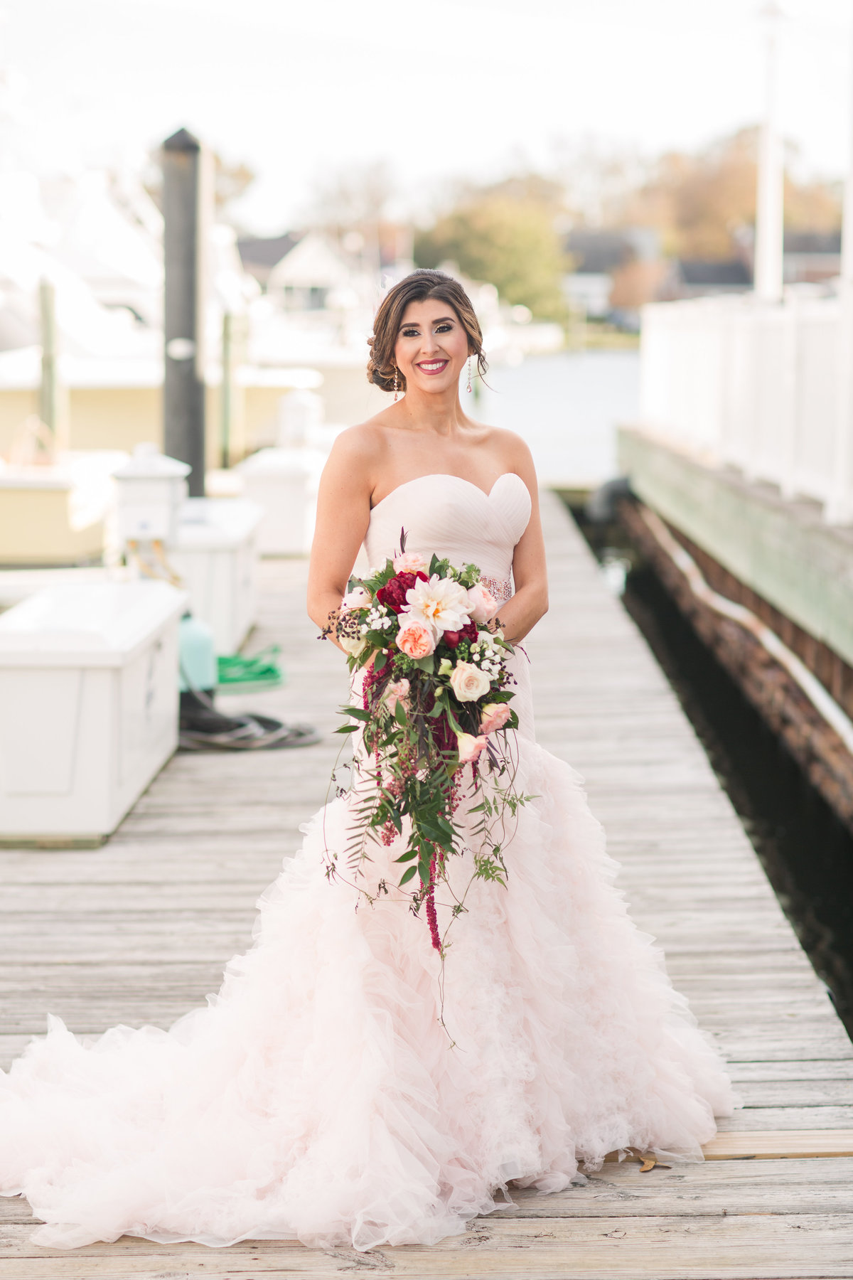 Beautiful bride in a blush gown posing at The Water Table