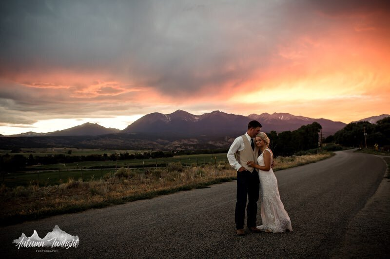 Everett Ranch Wedding Bride And Groom Hugging With A Mountain Sunset In Background
