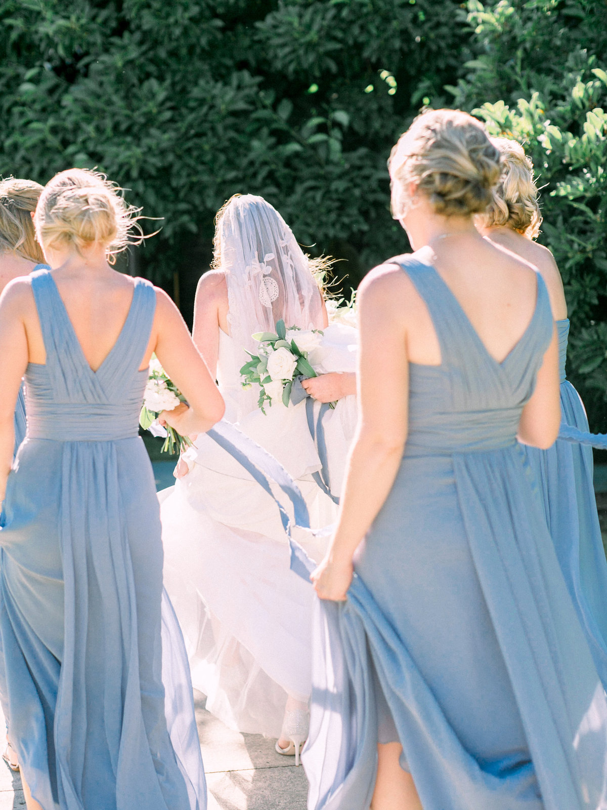 a bride walking with her bridesmaids