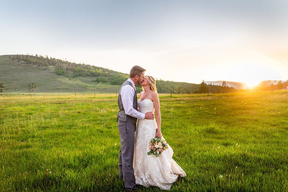Strawberry-Creek-Ranch-Wedding-Ashley-McKenzie-Photography-Small-Wildflower-Outdoor-Wedding-Sunset-kiss