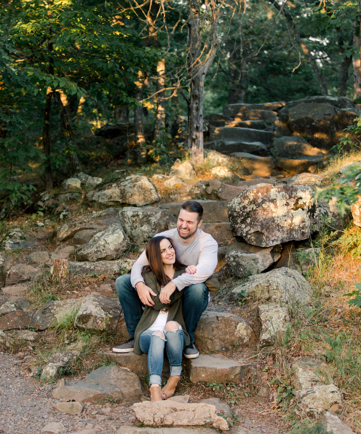 laughing couple on stone steps of interstate park at sunset minnesota