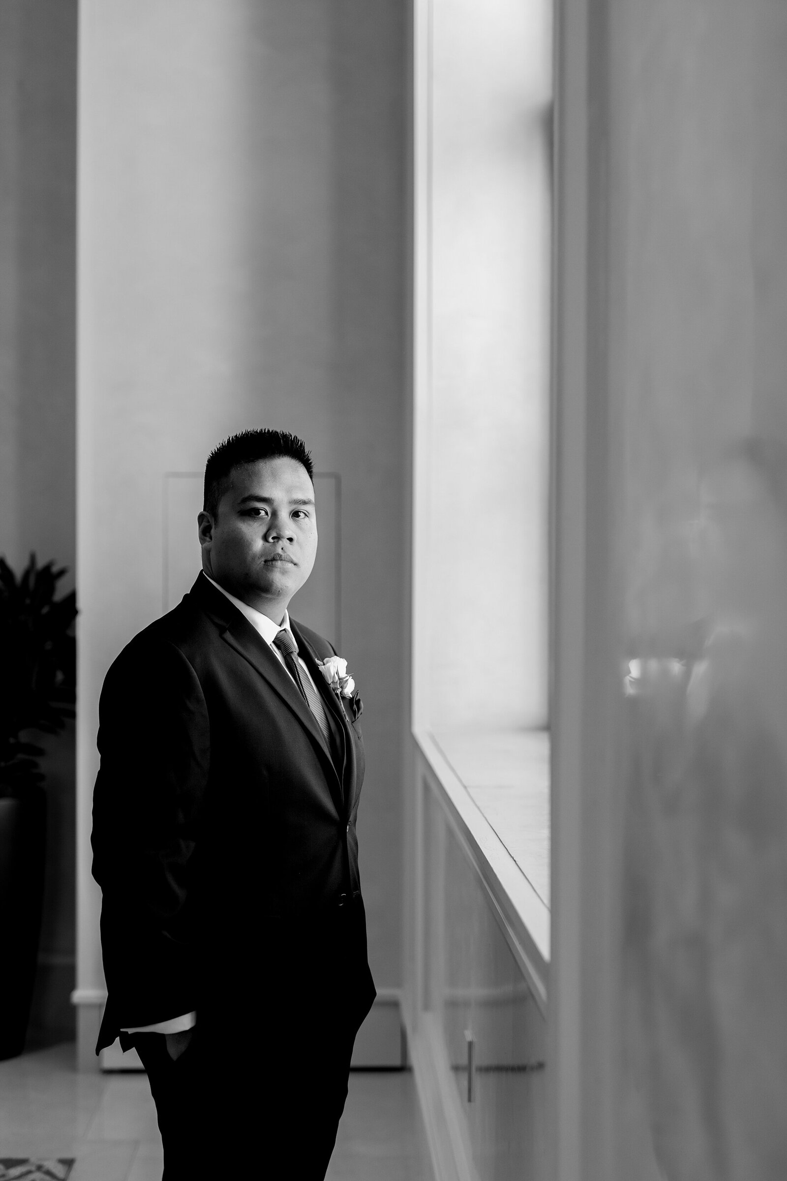 Groom in Jos A Bank Tux | Four Seasons Wedding | Chynna Pacheco Photography