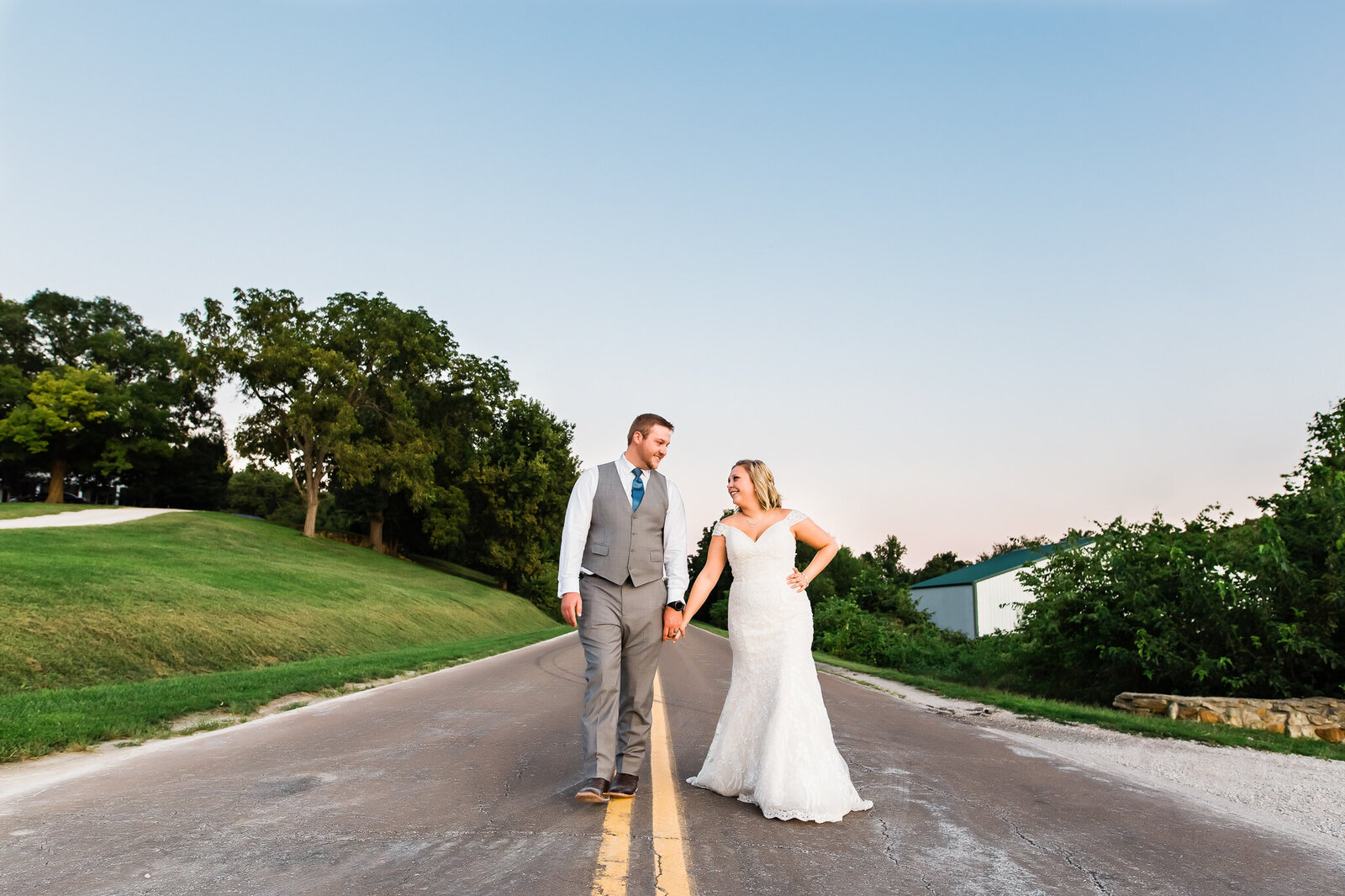 Bride and groom walking down the street together at their Kansas City wedding